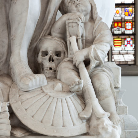Cherub with skull