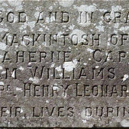 Bonvilston churchyard war memorial cross close up showing inscription stone
