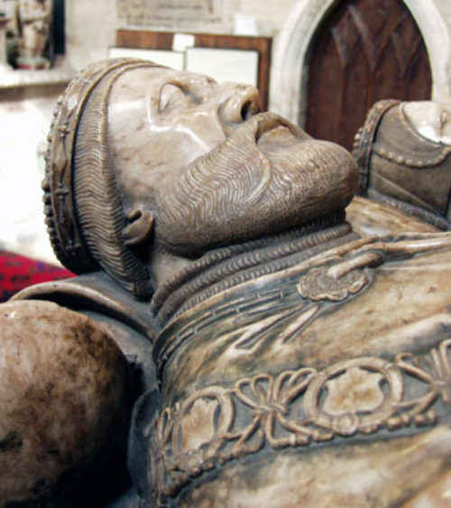 Fig 2 – Detail view of the Earls effigy showing his coronet and the mantle of the Order of the Garter