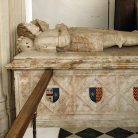 The effigies of Robert and his wife lie on a high tomb chest
