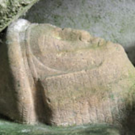 The effigy is of a military figure of oolithic limestone and dates from about 1250 01