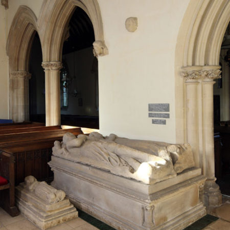 Unidentified female miniature tomb alongside the double monument to Thomas Berkeley d 1365 and his first wife in St Giles's church Coberley Gloucestershire Photo C B Newham