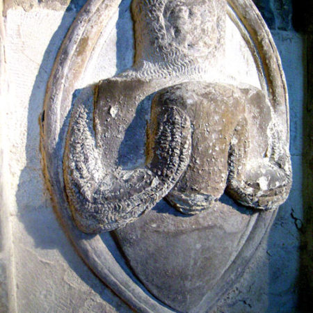 Wall memorial commemorating the heart burial of Sir Giles Berkeley d 1294 in St Giles's church Coberley Gloucestershire Photo Tim Sutton